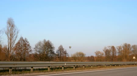 no traffic : Multi-lane highway with cars In the background, a balloon hangs over the trees. Stock Footage