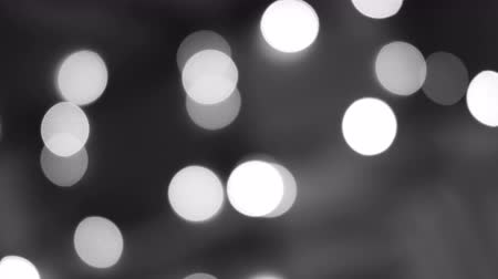 foltos : Blurred black and white lights. Defocused glittering bokeh festive background. Abstract light. Christmas or party concept.