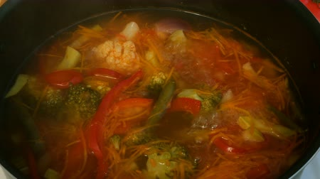 cserépedény : Homemade cooking. Concept of healthy vegetarian or lean food. Vegetable or minestrone soup cook in a metal saucepan on the stove.