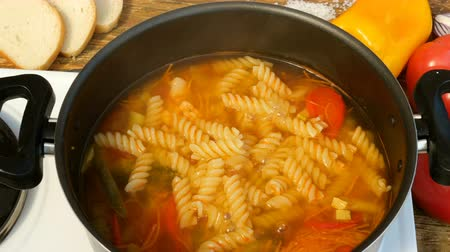 soup pans : Homemade cooking. Concept of healthy vegetarian or lean food. Vegetable or minestrone soup with pasta, cook in a metal saucepan on the stove.
