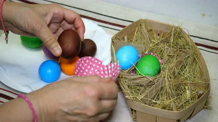 dyes : Homemade preparation for the holiday Easter. Easter eggs in basket with hay.