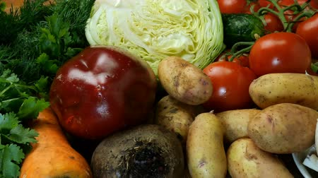 food preparation : Various raw vegetables for making vegetable soup, borscht, or a vegetarian healthy meal. As well as dill, parsley and other culinary herbs. Concept of healthy eating. Stock Footage