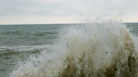 candida : Surf at Black Sea. Small waves splits with breakwater at Black sea near Odessa. Coastline, splashing, crashing, seafoam.
