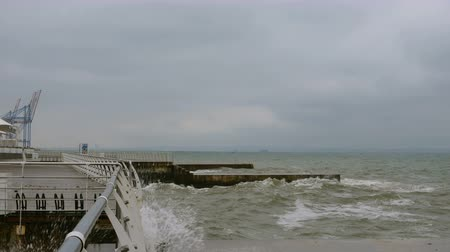 dalgakıran : Surf at Black Sea. Small waves splits with breakwater at Black sea near Odessa. Coastline, splashing, crashing, seafoam.