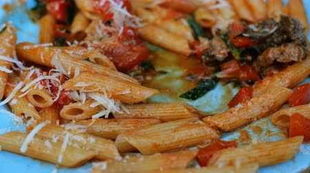 пармезан : Pasta with savory tomato sauce and meat sauce and parmesan. Pasta is a traditional dish of Italian and Mediterranean cuisine. Стоковые видеозаписи