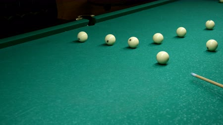 tágo : Pool Game. Billiard balls move with billiard table. Game of inept player on billiards. Russian billiards. Inaccuracies, blunders. Selective focus.