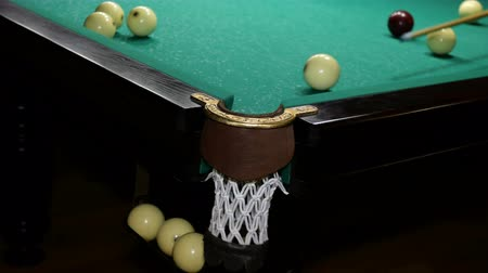 пари : Pool Game. Billiard balls move with billiard table. Game of inept player on billiards. Russian billiards. Inaccuracies, blunders. Selective focus.