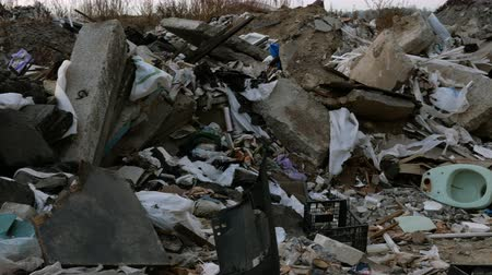 lebontották : Industrial and household waste. Large garbage pile. Degraded garbage. Dirty and stink waste in trash dump or landfill. Environmental damage concept. close-up.