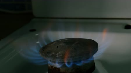 Natural gas burning. Fire from old burner stove top, in domestic kitchen for cooking with flames propane gas or methane burning. Close-up.