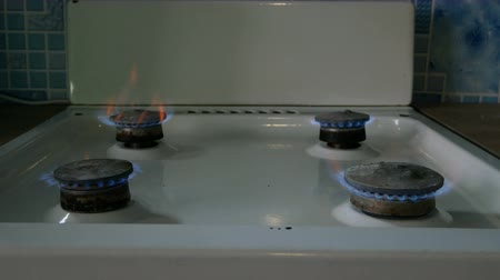 Natural gas burning. Fire from old burner stove top, in domestic kitchen for cooking with flames propane gas or methane burning. Medium plan.