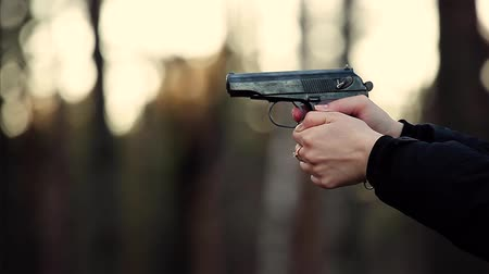 polícia : Girl shot with a gun in the forest. Woman doing shots with a pistol Makarov PM. The video contains real sound shot. FullHD 1080p