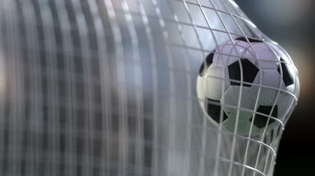 göller : soccer ball in goal net with slowmotion. Slowmotion football ball in the net.