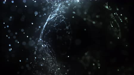 Water drops hits abstract dark object, slow motion 4k Stok Video