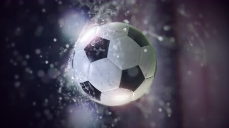 Soccer ball flying through water drops slow motion 4k
