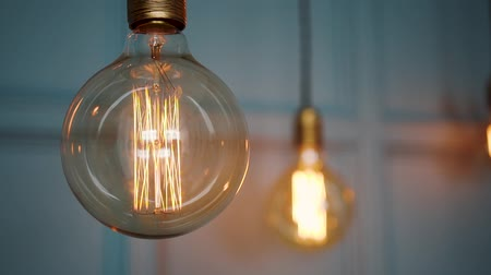 Vintage old bulb shining a yellow light. Retro electric glass lantern lighting, interior decoration. Archivo de Video