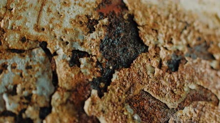 escovado : Brown and orange grunge rusty painted metal surface. Macro view of corrosion in iron metal, texture background. Smooth motion
