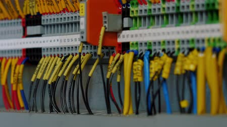cabling : Electrical control panel with multiple switches, wires, short circuit protection devices. Color cable terminal socket and electrical control device, close up.