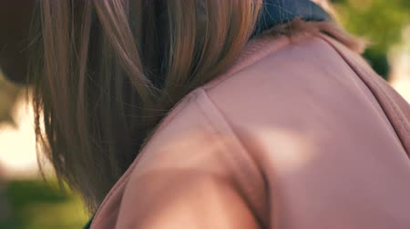 commute : Close Up of A Womans shoulder in the park. Slow motion Stock Footage