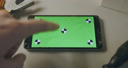 repairer : Checking phone with broken screen, smartphone with green screen