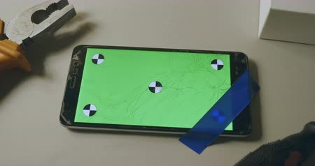 conector : Checking phone with broken screen, fixing, smartphone with green screen