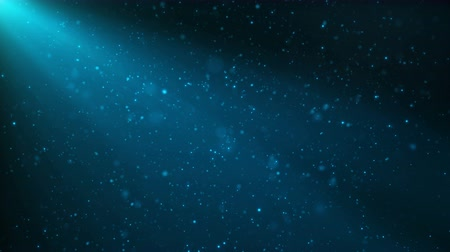Abstract motion background of shining, sparkling blue particles. Beautiful blue floating dust particles with shine light. Seamless Loopable 3D 4K Animation.