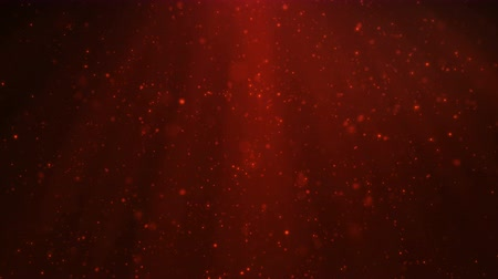 Abstract motion background of shining, sparkling, red particles. Beautiful red floating dust particles with shine light. Seamless Loopable 3D. 4K Animation