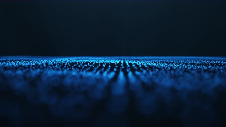 Abstract motion background of shining particles, digital wave, sparkling blue particles. Beautiful blue floating particles with shine light. Seamless Loopable 3D 4K.