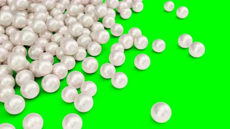 Falling and rolling pearls on a surface isolated on a green background. Jewelry pearl beads. Brilliant oyster pearl balls for luxury accessories. Brilliant sea pearls. 3D 4K animation