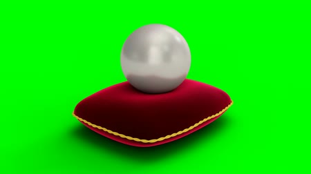 Rotated pearl with red velvet pillow on surface isolated on a green background. Jewelry pearl beads. Brilliant oyster pearl ball for luxury accessories. Brilliant sea pearl. 3D 4K animation