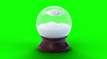 Snow globe with clouds from which snow is falling, against a green screen with alpha channel. Falling snowflakes inside from the clouds. Winter holidays concept: xmas New Year. Loop 4k 3d animation Wideo