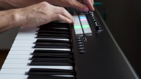 deceleration : Musician playing MIDI keyboard    MIDI controller synthesizer in studio - selective -focused piano keys closeup for electronic music production  recording