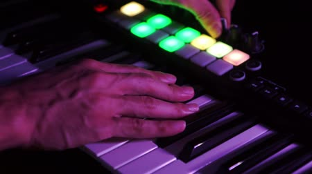 deceleration : Musician playing MIDI keyboard    MIDI controller synthesizer in concert - selective -focused piano keys closeup for electronic music production  recording  live concert