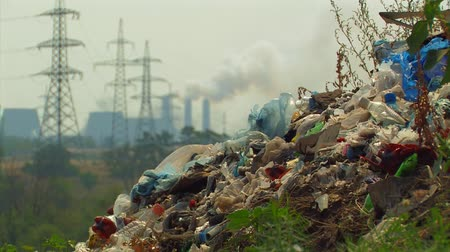 dumanlı sis : Global pollution. Landfill on the background of smoking chimneys and powerlines.