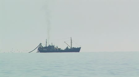 fishing industry : Fishing boat in the sea.