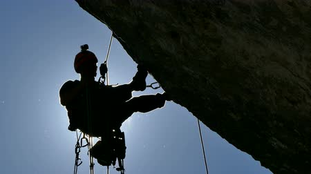 cliff : Silhouette of a Rock Climber