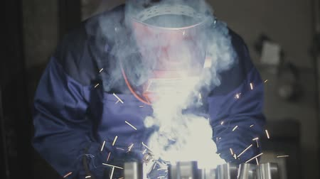 metal worker : Welder working in manufacturing Stock Footage