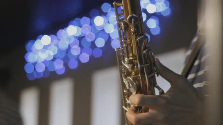 woodwind : saxophonist playing the instrument Stock Footage