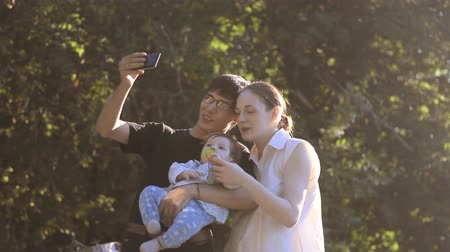 parenthood : family having fun in the park at sunset Stock Footage