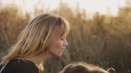 den matek : daughter and mother kissing and playing in the sunset light Dostupné videozáznamy