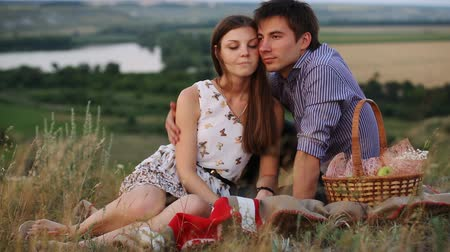 in : young couple enjoying a picnic outdoors