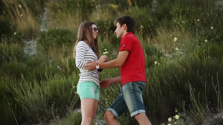 склон холма : the guy at the hillside gathering flowers for his girlfriend and gives her