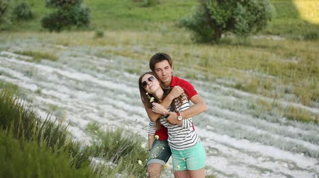 an : young couple enjoying the outdoors in the mountains