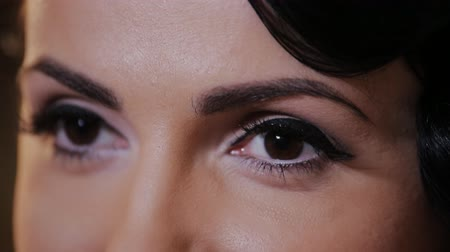 close up shot : elegant woman engaged in a dialogue. Close-up shot of female eyes makeup Stock Footage