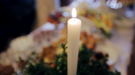 aglow : at the wedding table burning candle Stock Footage