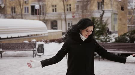 teen action : happy girl throws snow in winter park Stock Footage