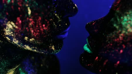 fantasy fantastic : Man and woman face in ultraviolet light