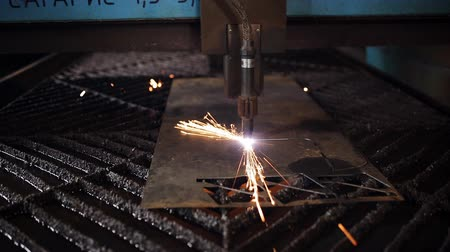 industry : The industrial laser cuts a metal sheet Stock Footage