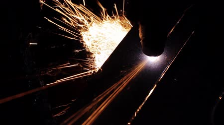 sheet : Cutting of metal. Sparks fly from laser