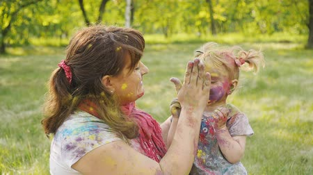 indian ethnicity : Family playing in the park. Family painted in the colors of Holi Festival Stock Footage