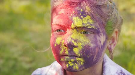 nepořádek : Portrait of a cute girl painted in the colors of Holi festival.